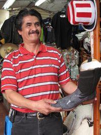0487-Man selling exotic cowboy boots, San Juan de Dios-Ellen Perlman